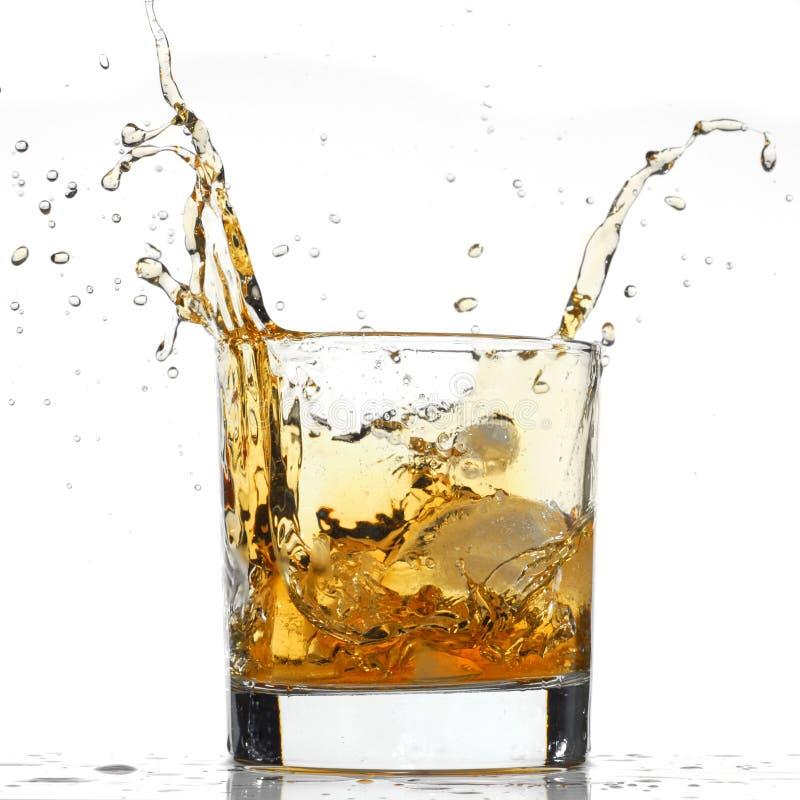 Download Spruzzata del whisky immagine stock. Immagine di spruzzata - 7310629