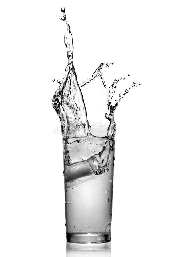 Spruzzata dell'acqua in vetro fotografia stock