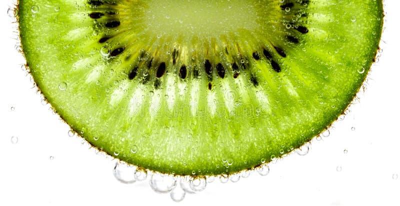 Spruzzata della fetta del kiwi fotografie stock
