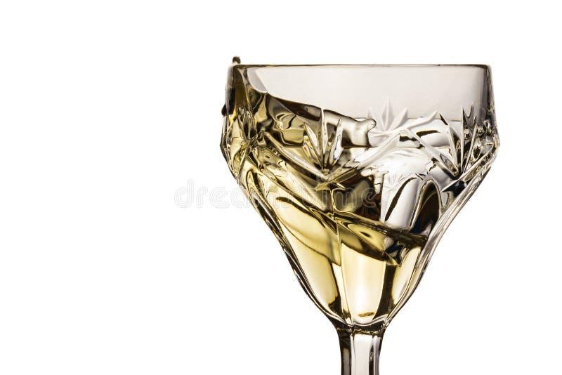 Spruzzata di vino bianco in un vetro d'annata immagine stock libera da diritti
