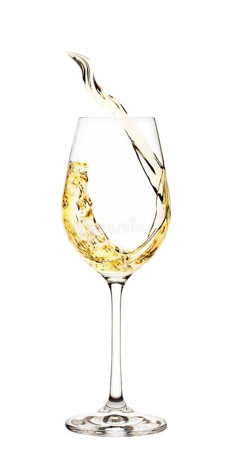 Spruzzata di vino bianco in vetro fotografie stock libere da diritti