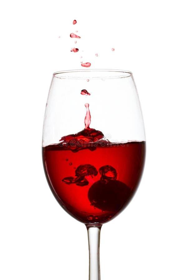 Spruzzata di vino rosso che somiglia ad una piccola esplosione fotografia stock libera da diritti
