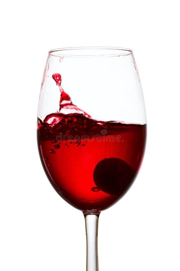Spruzzata in un bicchiere di vino fotografia stock libera da diritti