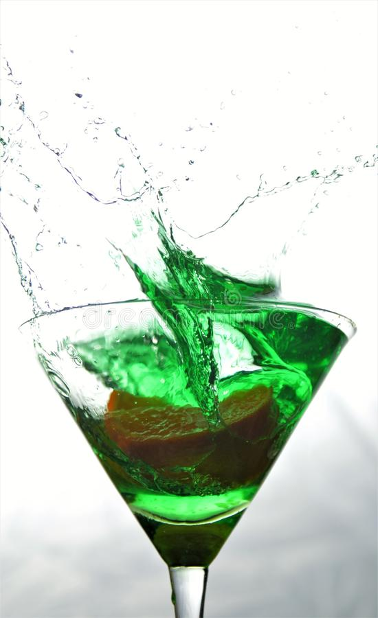 Spruzzata verde di Martini immagine stock