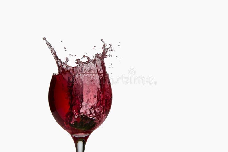 Spruzzatura del vino rosso immagini stock