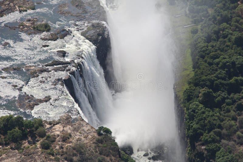 Spruzzo dei colpi aerei della cascata di Victoria Falls dall'elicottero fotografia stock libera da diritti