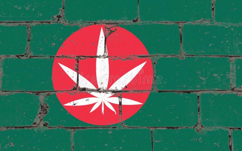 Spruzzo di arte della via dei graffiti che attinge stampino Foglia bianca della cannabis sul muro di mattoni con la bandiera Bang immagini stock