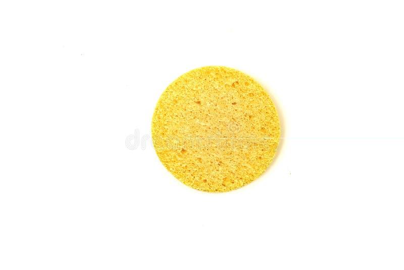 spugna gialla per il viso isolato su fondo bianco fotografie stock