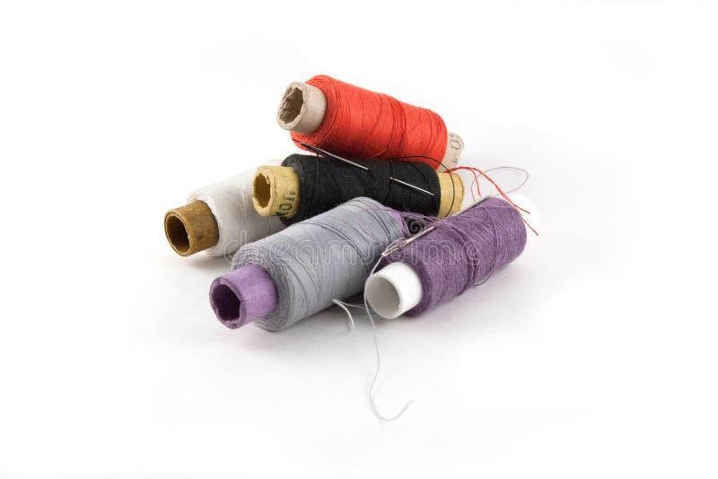 Spule des Threads und der Nadel stockfoto