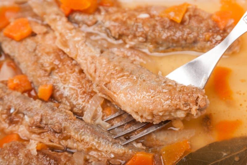 Spuntino succoso uno sperlano marinato arrosto con la carota fotografia stock