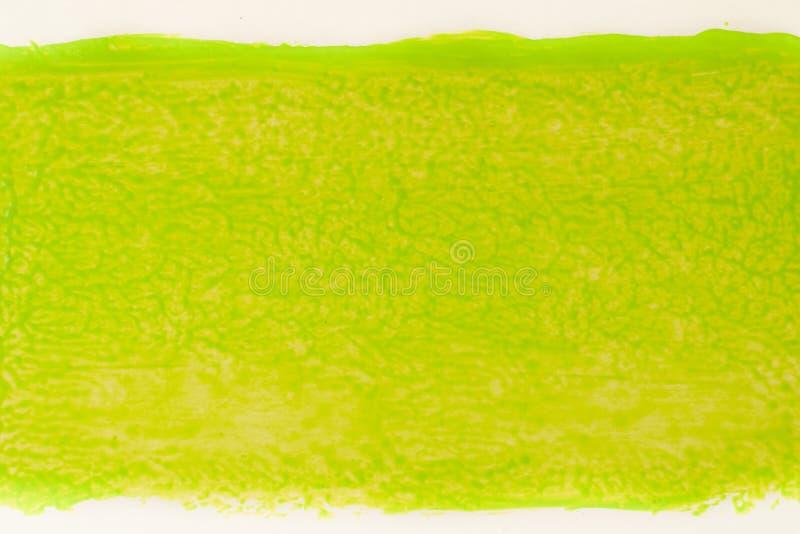 Spur der grünen Farbe von der Rolle für das Malen auf Wand Reparieren Sie Konzept lizenzfreie stockfotografie