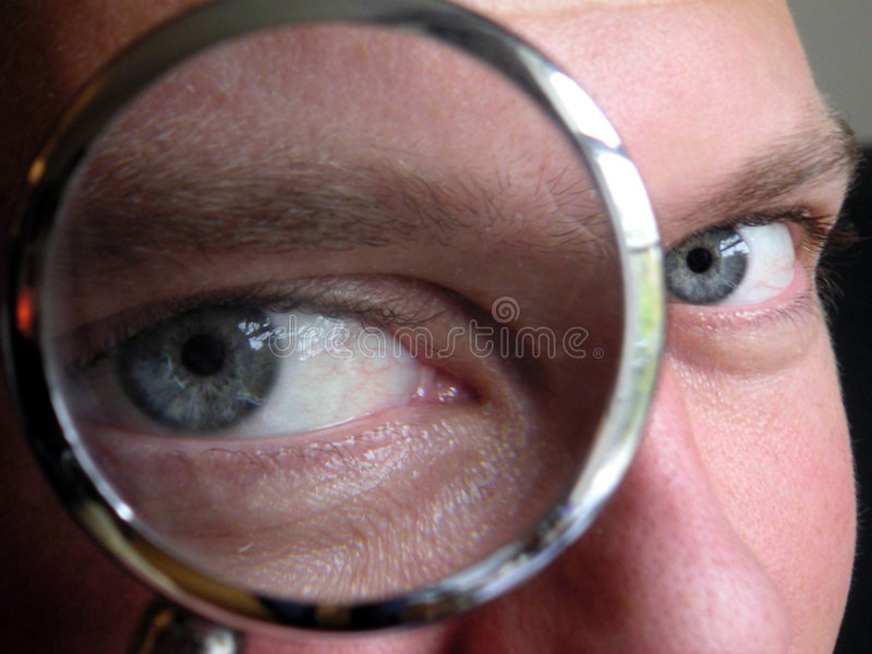 Spy. Man looking through magnifying glass stock image