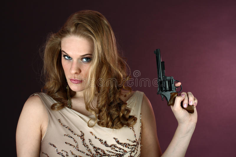 Spy Girl With Gun Pointing Up On Red Background Stock Image