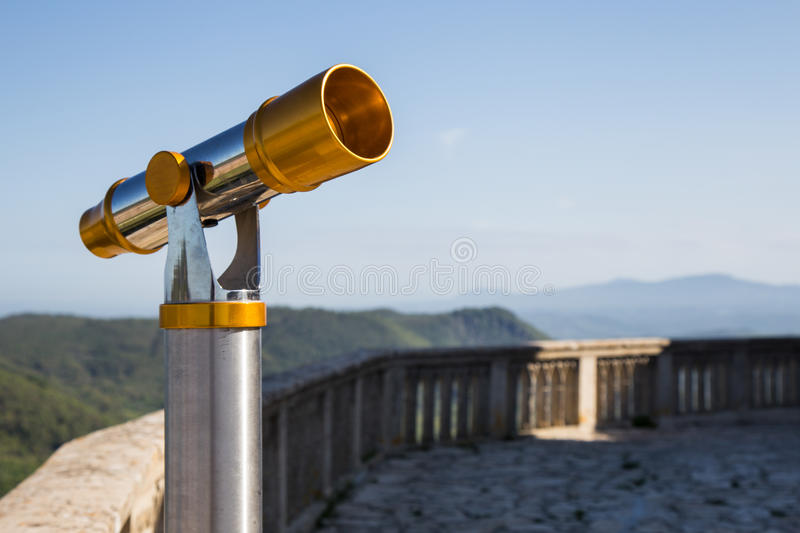 Spyglass. Telescope for viewing the surrounding landscape stock image