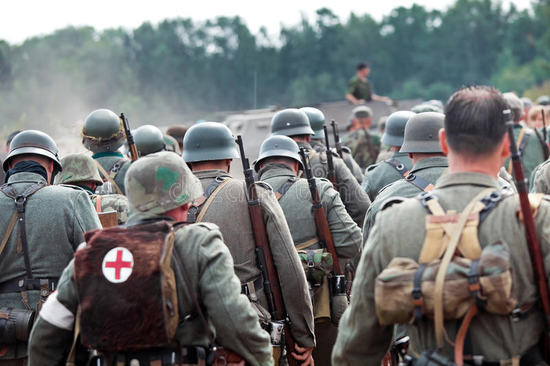 Squad of german soldiers. On historical reconstruction of the Second World War stock photo