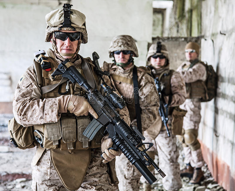 Squad of marines. Squad of US marines in ruined building royalty free stock photo