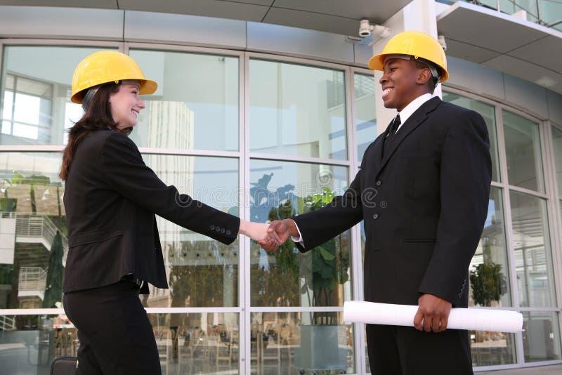 Squadra della costruzione della donna e dell'uomo immagine stock libera da diritti