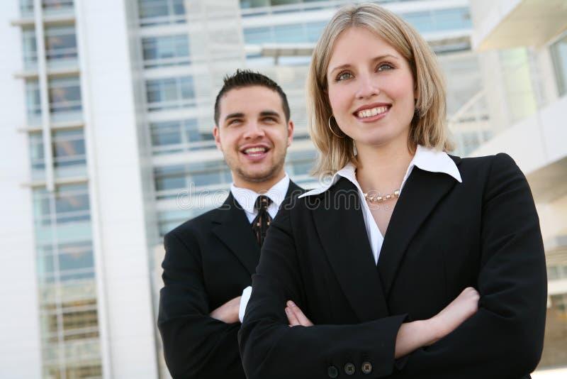 Squadra di affari della donna e dell'uomo immagine stock
