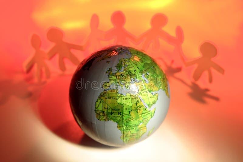 Squadra e globo immagine stock libera da diritti