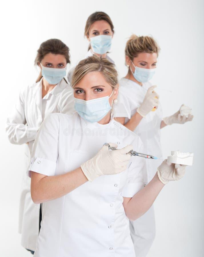 Squadra femminile del dentista immagini stock libere da diritti