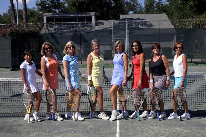 Squadra femminile di tennis immagine stock