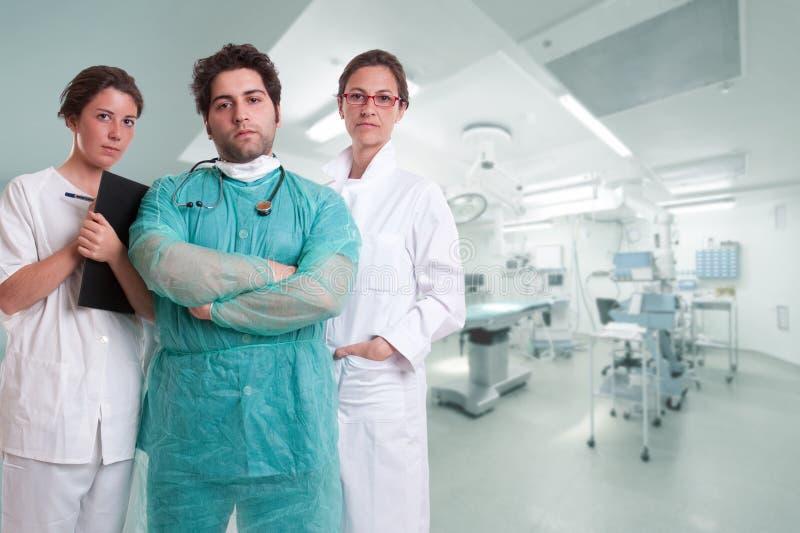 Squadra seria di chirurgia fotografia stock