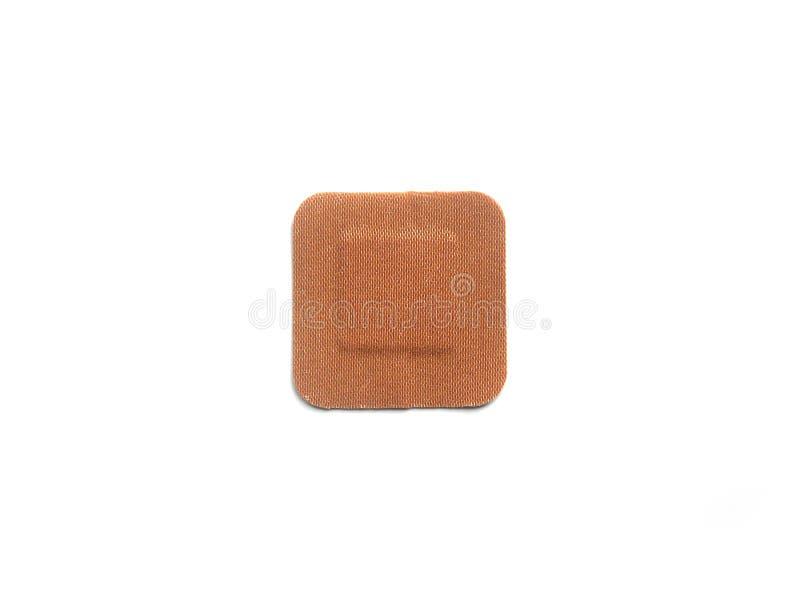 Square adhesive bandage. Small square shape adhesive bandage on white background royalty free stock images