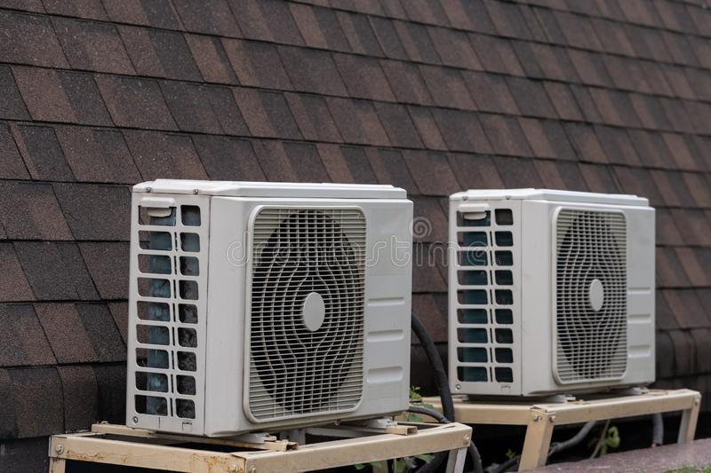 Square air conditioner on the roof with a round fan royalty free stock image