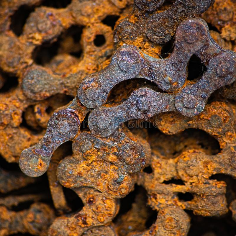 Square background with rusty industrial roller chain, soft focus. Square background with rusty industrial bush roller chain, soft focus, mechanical, steel, iron royalty free stock photo