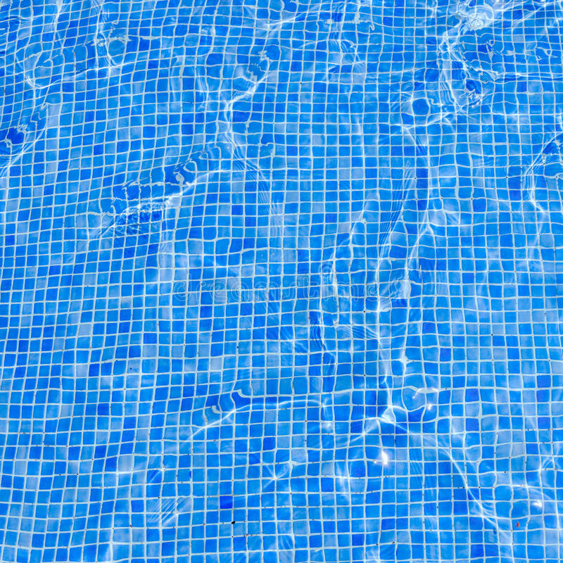 Square background swimming pool floor water covered blue tiles royalty free stock image