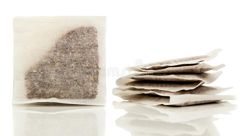 Square bag of herbal tea on a white background stock image