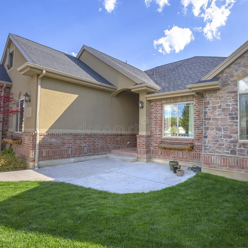 square beautiful exterior home brick wall landscaped yard arched entryway square beautiful exterior home brick 168709608