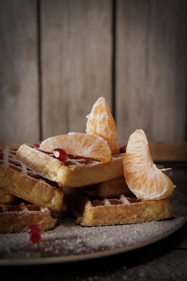 Square Belgian waffles with a tangerine pomegranate royalty free stock images
