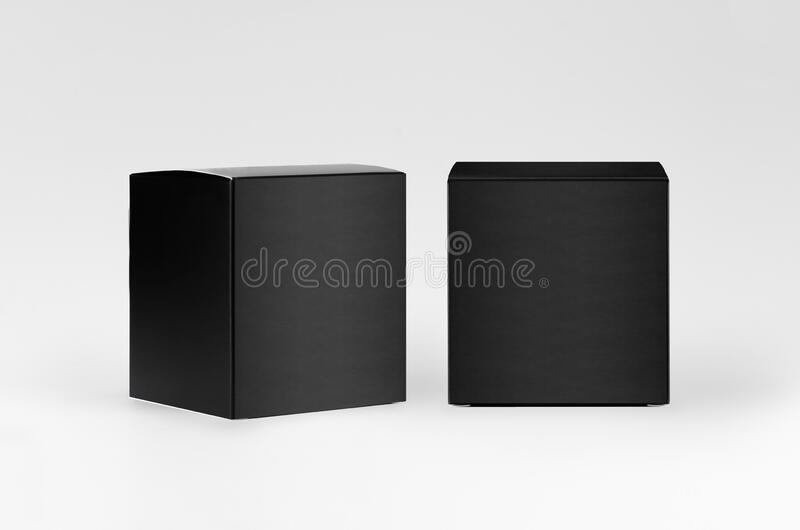 Square black paper boxes side, front view on white background, mock up of packing, branding identity of product, advertising. Square black paper boxes side royalty free stock photo
