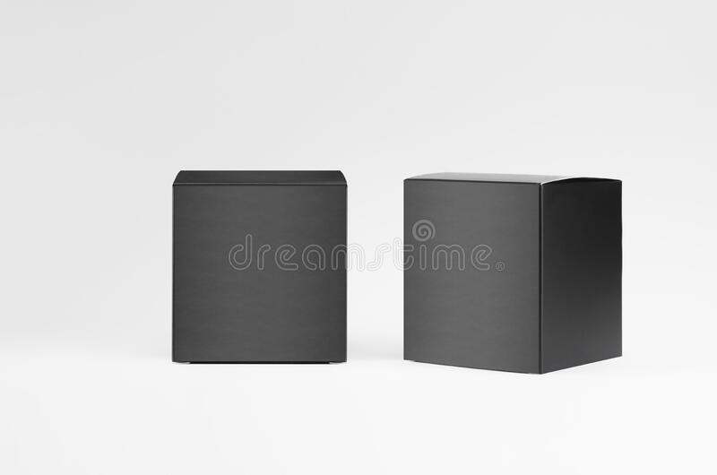 Square black paper boxes side, front view on white background, template of packing, branding identity of product, advertising. Square black paper boxes side royalty free stock photography