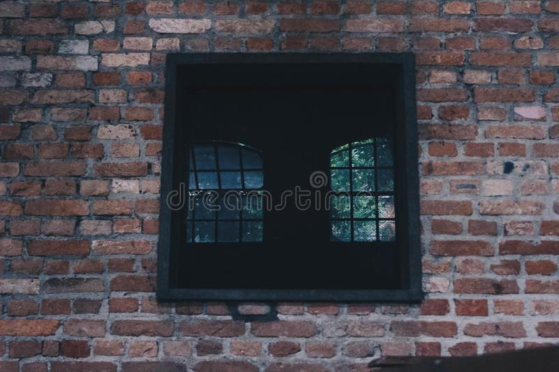 Square Black Window on Concrete Wall royalty free stock images