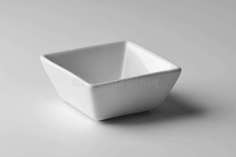 Square Bowl in white porcelain royalty free stock photos