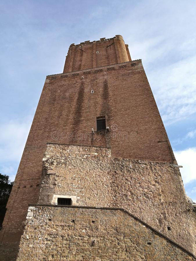 Square brick tower of the militias in the Trajan Market in the historical center of Rome, Italy. royalty free stock image
