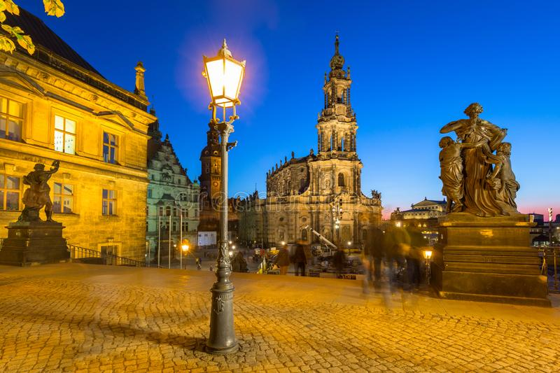 Square at the Cathedral of Heliga Trinity and Dresden Castle in Saxony in night, Germany arkivfoton