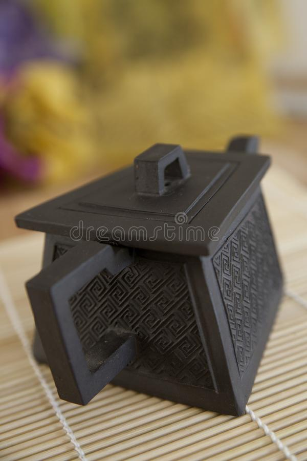 Square ceramic Japanese Teapot with Texture stock image