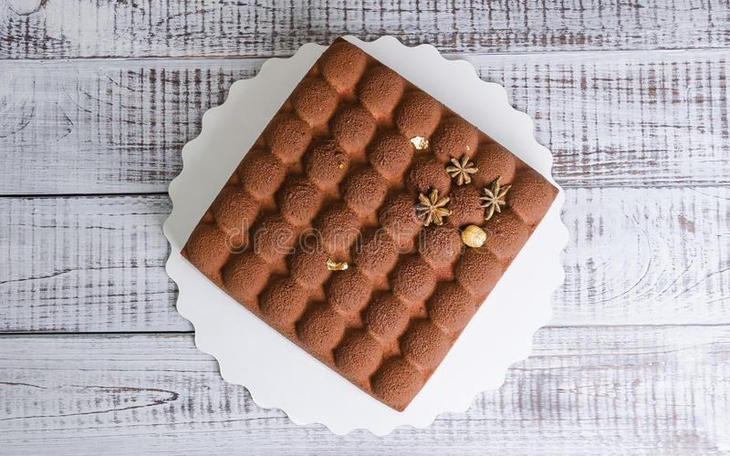 Square chocolate velour mousse cake. A square chocolate velour mousse cake stock photos