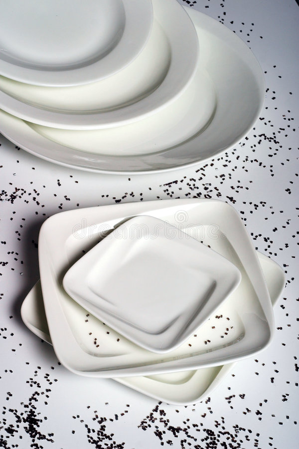 Square and circular plates stock images