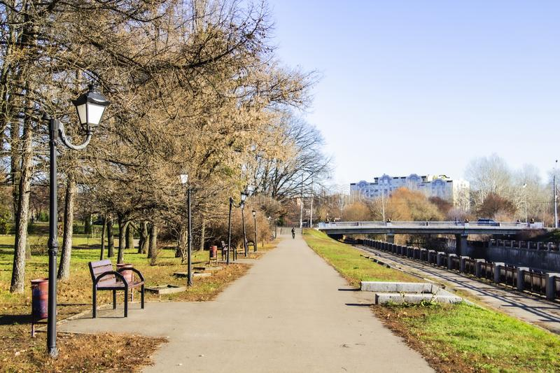 The square in city Sumy.Bridge. The road in the park. Ukraine. The square in city Sumy. The road in the park. Ukraine stock photo