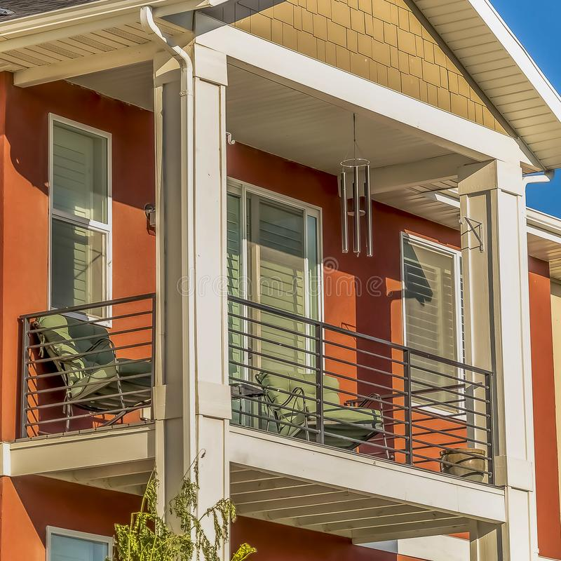 Square Close up of the small balcony of a home against clear blue sky on a sunny day royalty free stock photo