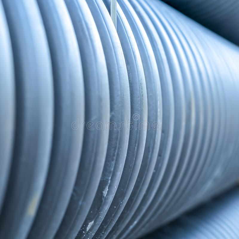 Square Close up view of shiny metal pipes at a construction site on a sunny day royalty free stock photos