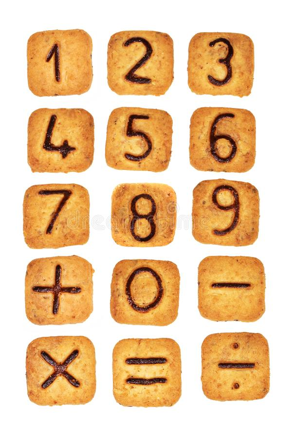 Square cookies with chocolate numerals on them isolated on white background. Figures from zero to nine stock photo