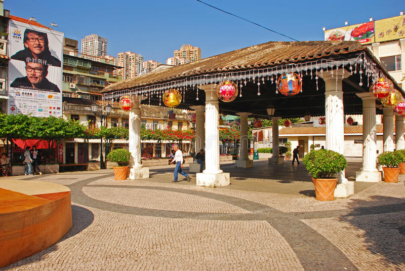 Square with covered area at one end of Rua da Cunha. Cobblestone Spacious Square with covered area at one end of Rua da Cunha in Macau royalty free stock photos