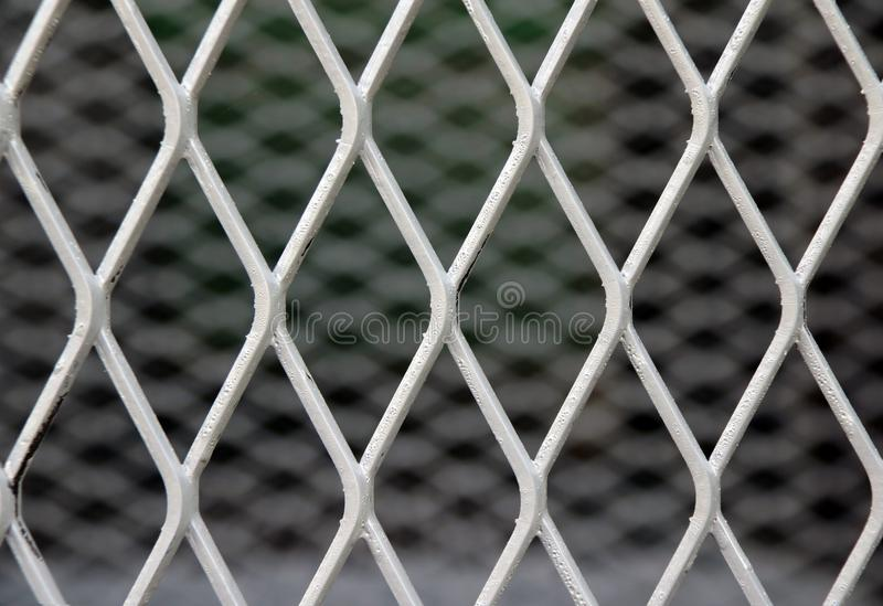 Square diagonal pattern of metal cage. pattern of Steel grating. It is a framework of spaced bars that are parallel. Square diagonal pattern of metal cage royalty free stock photos