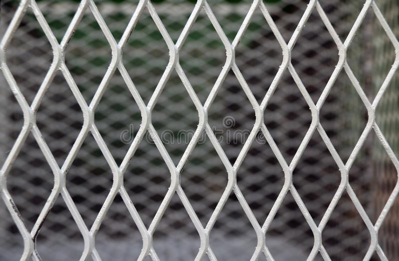 Square diagonal pattern of metal cage. pattern of Steel grating. It is a framework of spaced bars that are parallel to or cross each other. Use for wall, fence stock image