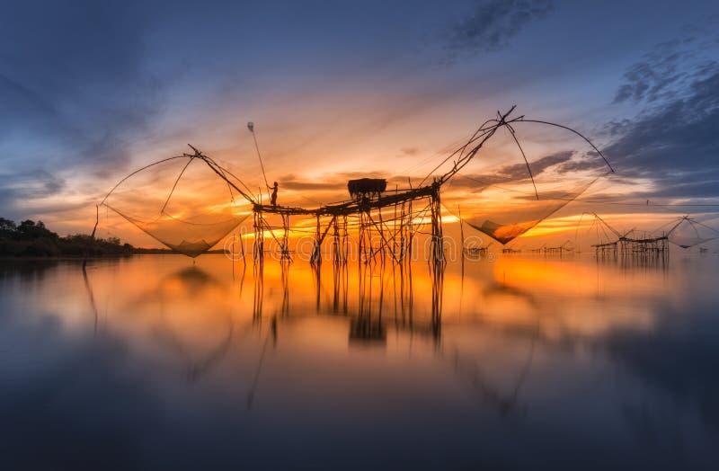 Square dip net catch fish at sunrise,Pakpra,Phatthalung, Thailan stock image